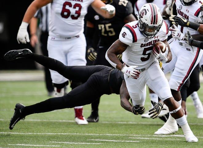South Carolina running back Rico Dowdle (5) is tackled by Vanderbilt safety Zaire Jones (6) during the first half at Vanderbilt University in Nashville, Tenn., Saturday, Sept. 22, 2018.