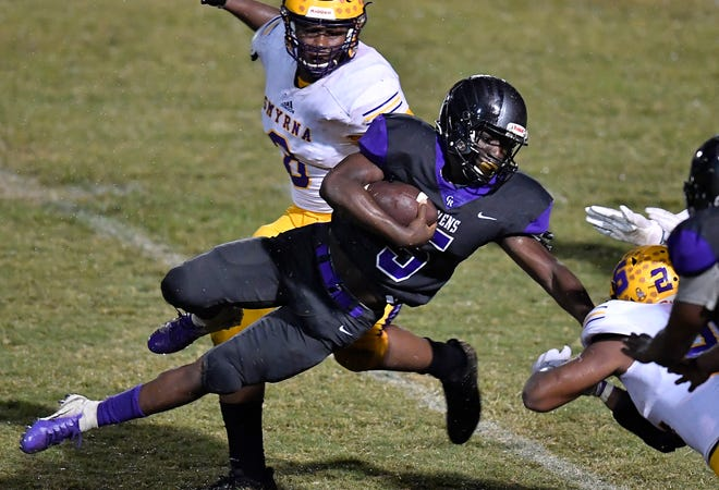 Cane Ridge running back Devon Starling (5) is stopped by the Smyrna defense during the second half of Friday's game.
