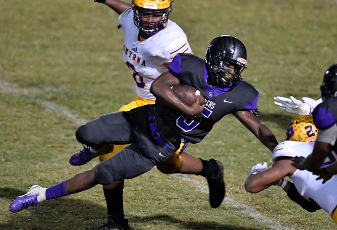 Cane Ridge Devon Starling (5) is stopped by the Smyrna defense during the second half at Cane Ridge High School Friday, Sept. 21, 2018, in Nashville, Tenn.