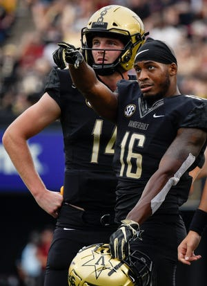 Vanderbilt wide receiver Kalija Lipscomb (16) and quarterback Kyle Shurmur (14) watch the replay on what would be ruled a touchdown scored by Lipscomb during the first half against South Carolina on Saturday.