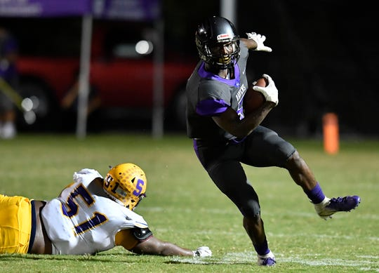 Cane Ridge's Devon Starling (5) speeds past Smyrna's Marlon Alexander (51) during the game at Cane Ridge High School Friday, Sept. 21, 2018, in Nashville, Tenn.