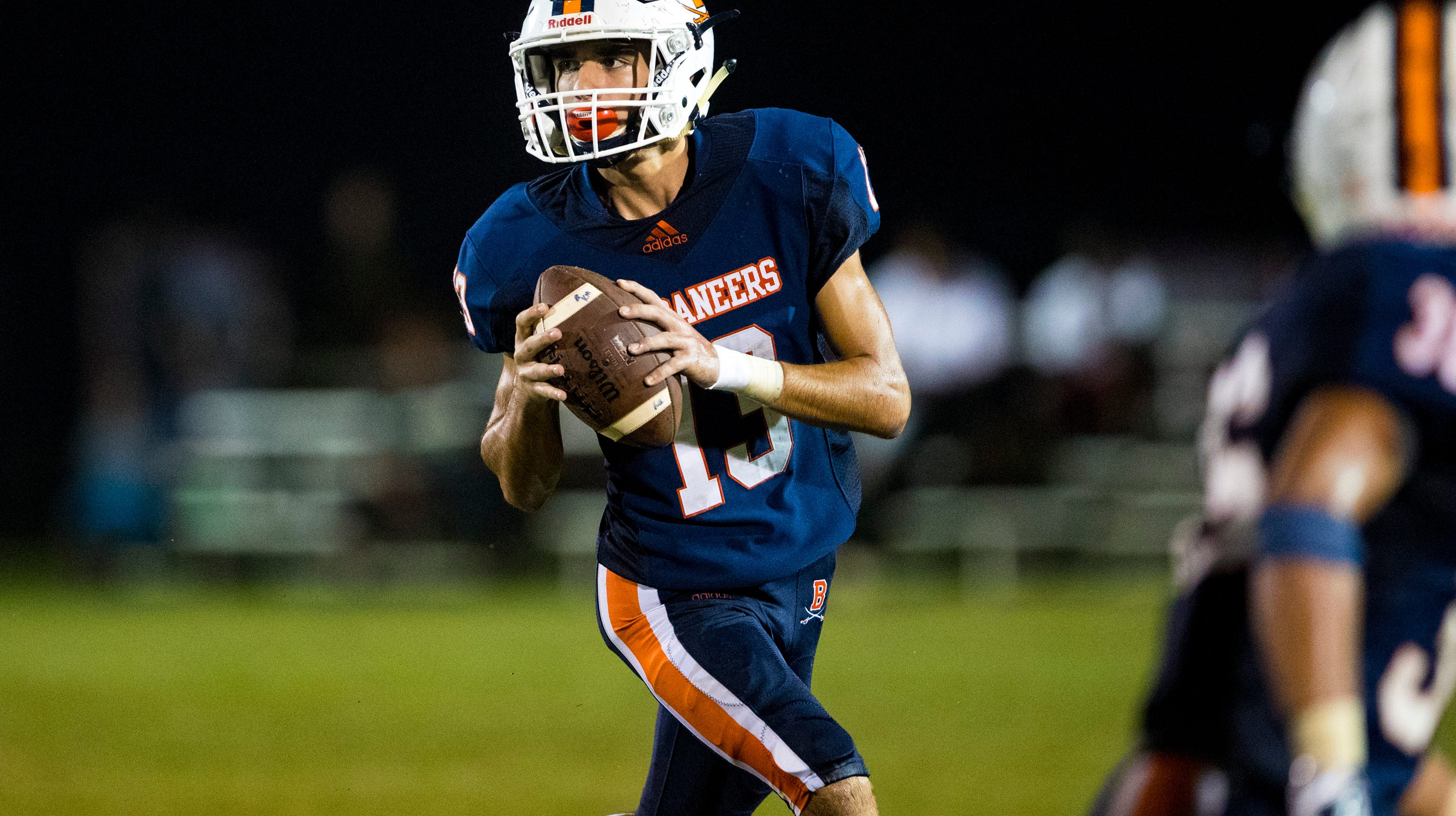Beech's Bobby Whitley (13) looks downfield during...