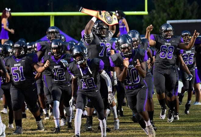 Cane Ridge takes the field for its game against Smyrna on Friday.