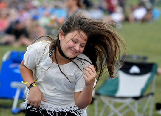 Ella Bench, 11, of Jackson, Ms., dances to the music at Pilgrimage Festival at The Park at Harlinsdale Farm Saturday, Sept. 22, 2018, in Franklin, Tenn.