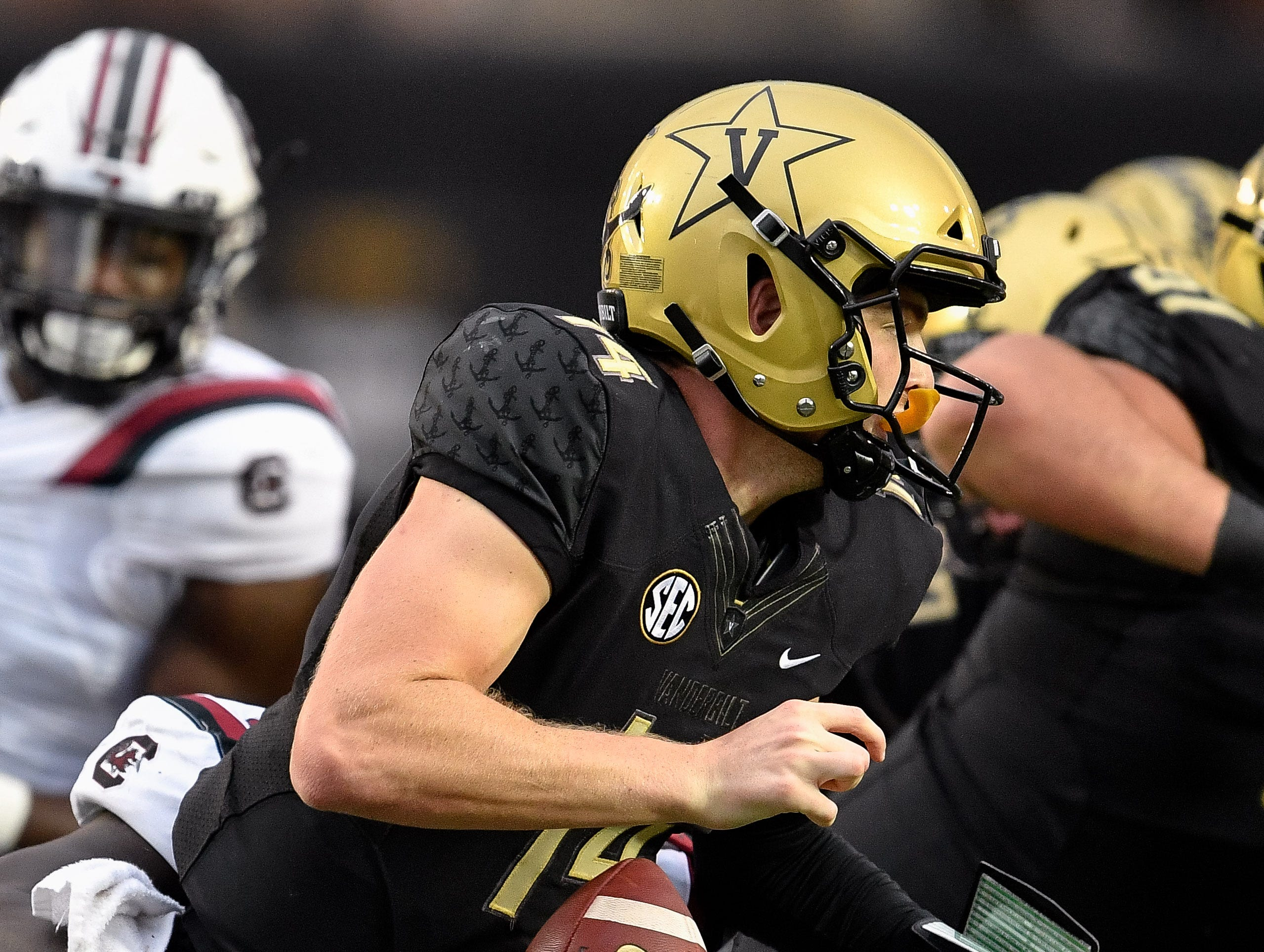 Vanderbilt quarterback Kyle Shurmur (14) fumbles on a hit from South Carolina defensive lineman Javon Kinlaw (3) during the second half at Vanderbilt University in Nashville, Tenn., Saturday, Sept. 22, 2018.