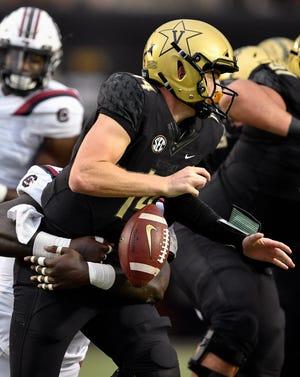Vanderbilt quarterback Kyle Shurmur (14) fumbles on a hit from South Carolina defensive lineman Javon Kinlaw (3) during the second half at Vanderbilt University in Nashville, Tenn., Saturday, Sept. 22, 2018.