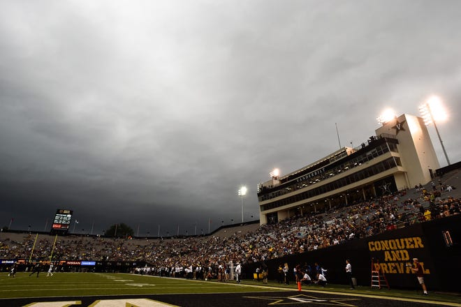 Storm clouds are seen over Vanderbilt Stadium shortly before a weather delay is called during the second half of the game against South Carolina on Sept. 22.
