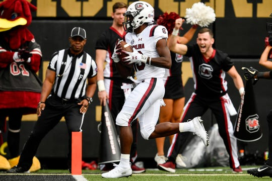 South Carolina wide receiver Shi Smith (13) scores a touchdown against Vanderbilt during the first half at Vanderbilt University in Nashville, Tenn., Saturday, Sept. 22, 2018.