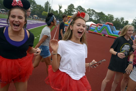 Piper Moralez and Ellie Sudderth, both 16, cheer as Father Ryan High School begins its 10th annual Relay for Life fund raiser for cancer research on Saturday.  Hundreds of cancer survivors, caregivers, family members and other supporters participated.
