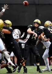 Vanderbilt quarterback Kyle Shurmur (14) throws a pass against South Carolina during the first half at Vanderbilt University in Nashville, Tenn., Saturday, Sept. 22, 2018.