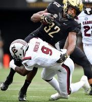 Vanderbilt running back Jamauri Wakefield (32) is tackled by South Carolina defensive back Keisean Nixon (9) during the first half at Vanderbilt University in Nashville, Tenn., Saturday, Sept. 22, 2018.