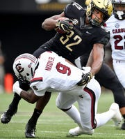 Vanderbilt running back Jamauri Wakefield (32) is tackled by South Carolina defensive back Keisean Nixon (9) during the first half at Vanderbilt University in Nashville, Tenn., Saturday, Sept. 22, 2018.
