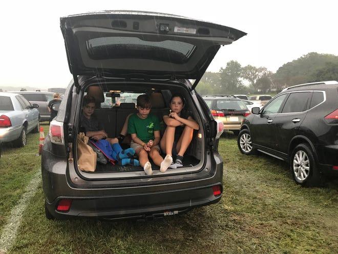 Waiting out the rain at Pilgrimage Festival are (from left) Duncan St. Frances, 10, of Hendersonville; Harper O'Neal, 9, of Atlanta; Conner St. Frances, 12, of Hendersonville; and Gretchen O'Neal, 11, of Atlanta.