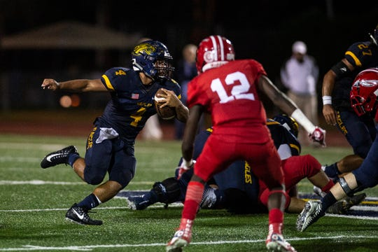 Naples High School's Elan Sommala runs the ball during a game against Immokalee last Friday. The Eagles go on the road to open district play at Palmetto Ridge on Friday.