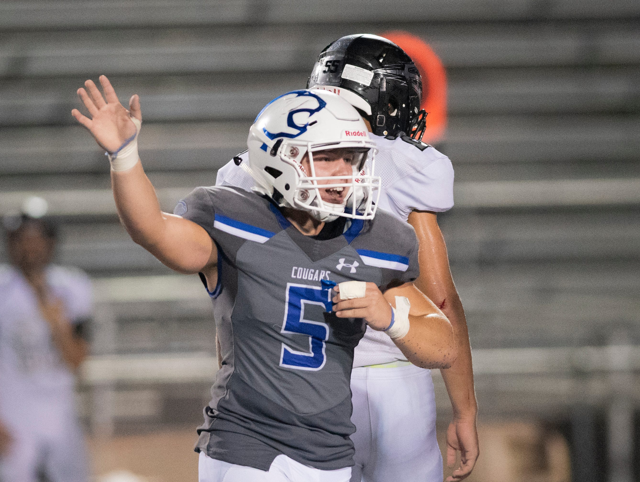 Cole Vandergrift of Barron Collier celebrates his team coming up with a Mariner fumble during the game at Barron Collier High Friday night, September 21, 2018.