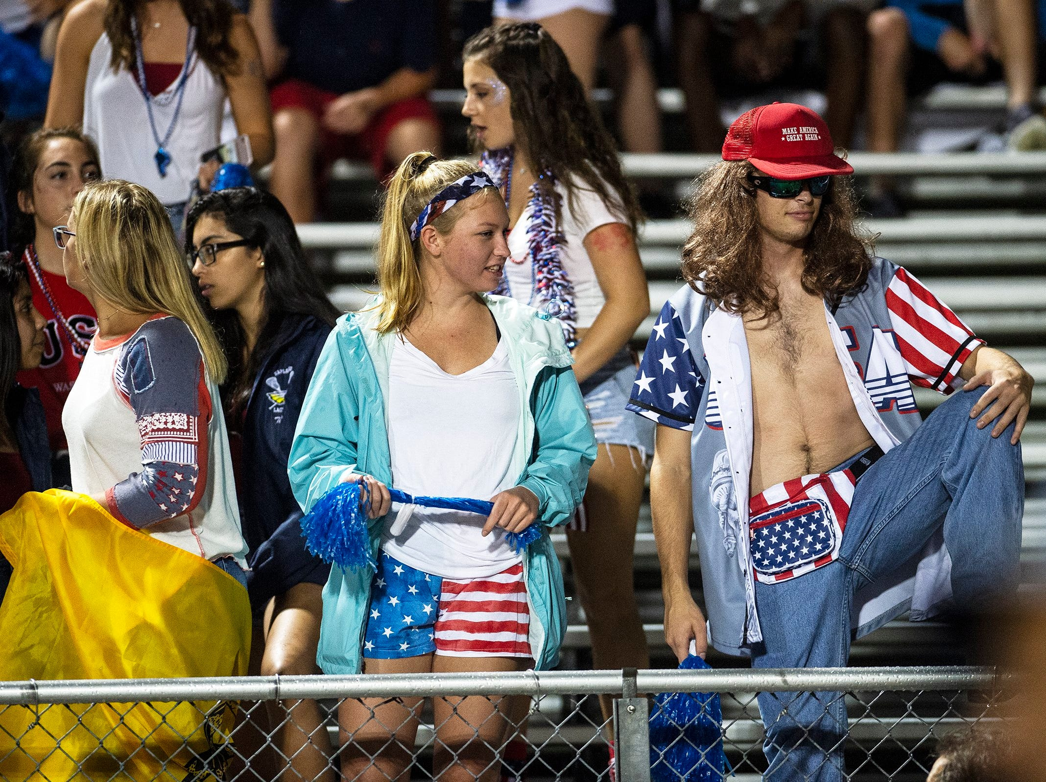 Naples High School students watches as players take the field during a game against Immokalee High School in Naples, Fla. on Friday, September 21, 2018.