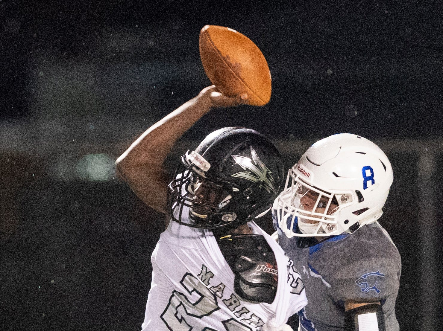 Tyler Echeverry of Barron Collier tries to bring down Mariner quarterback Rashawn Hunter during the game at Barron Collier High Friday night, September 21, 2018.