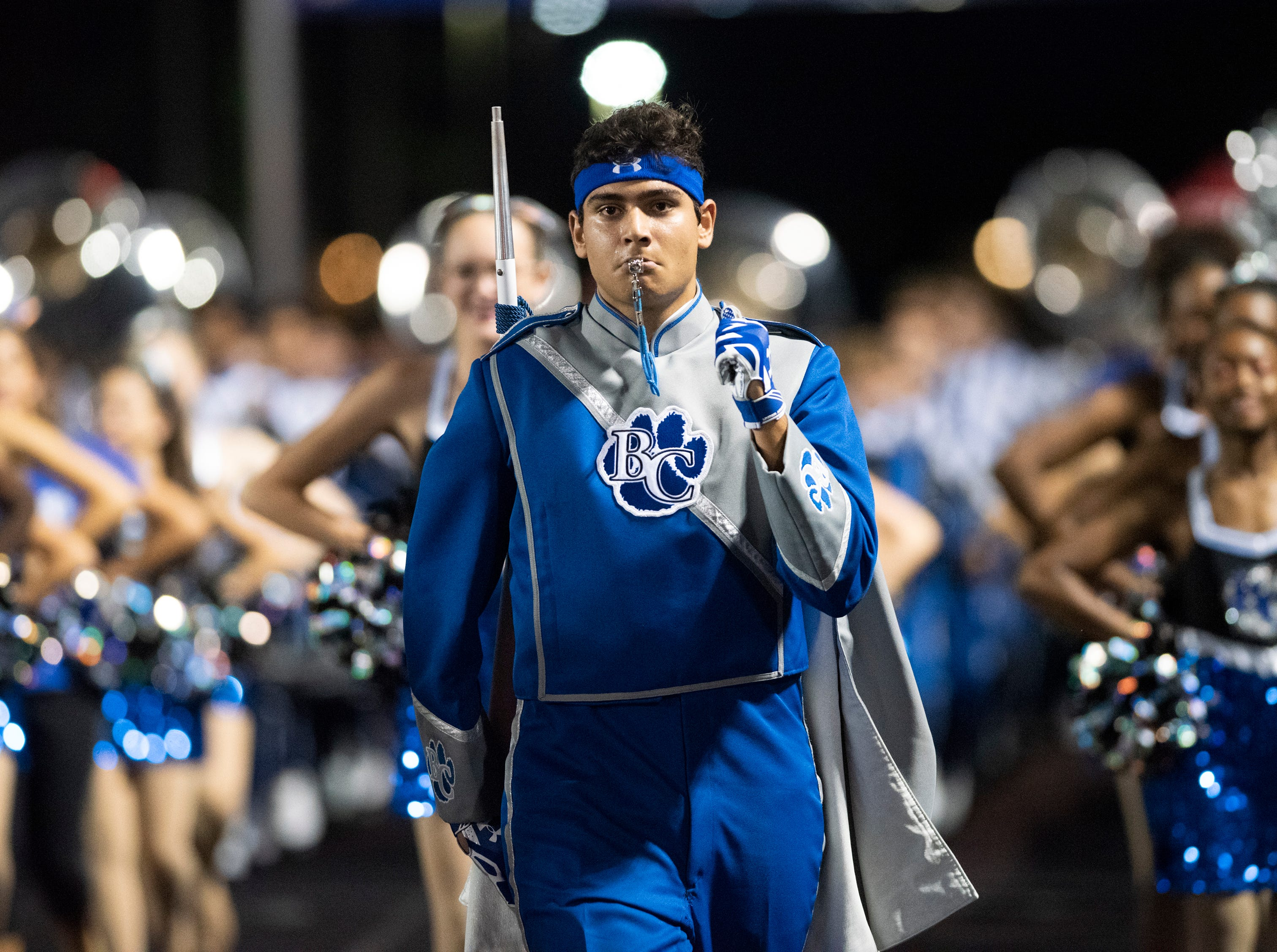 Barron Collier drum major Michael Dina leads the band onto the field before the start of the game against Mariner at Barron Collier High Friday night, September 21, 2018.