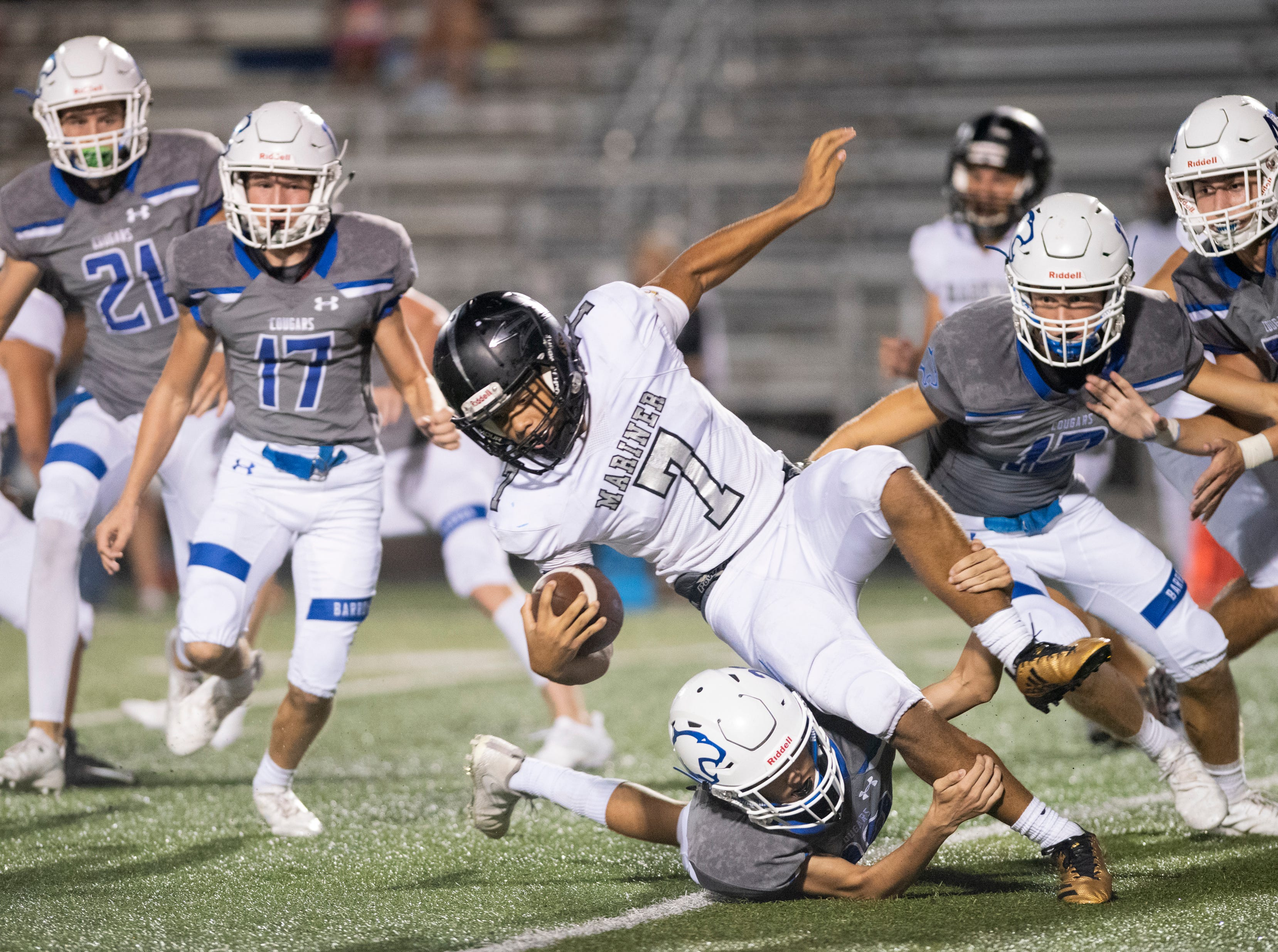 Mariner running back Jaiden Critten is hit by a Barron Collier defender during the game at Barron Collier High Friday night, September 21, 2018.