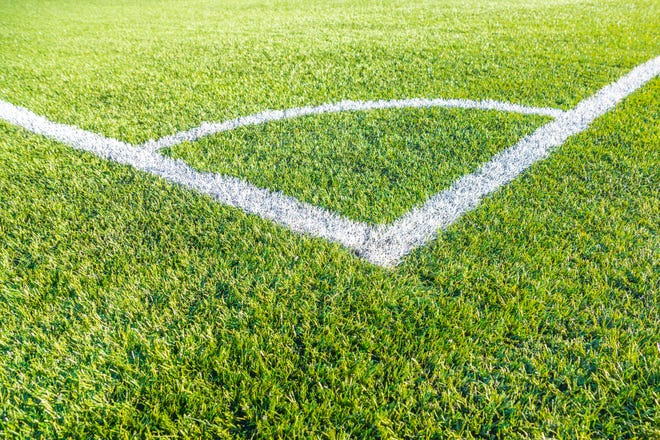 Corner kick football/soccer field outline on green artificial grass.