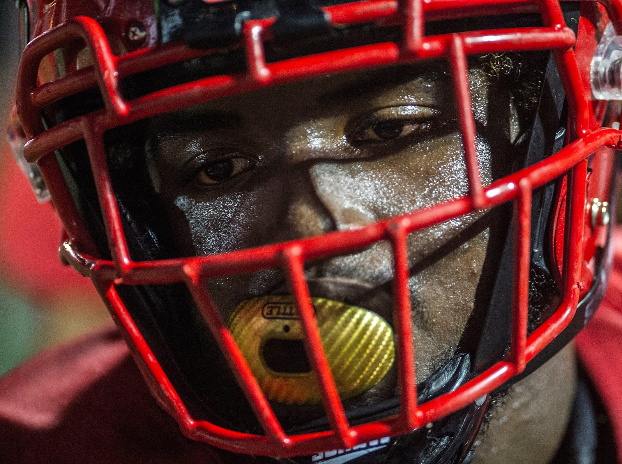 An Immokalee High School player takes a rest during a game against Naples High School in Naples, Fla. on Friday, September 21, 2018.