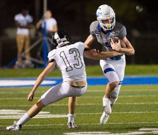 Micheal Mclay of Barron Collier is tackled by Dylan Silverman of Mariner during the game at Barron Collier High Friday night, September 21, 2018.