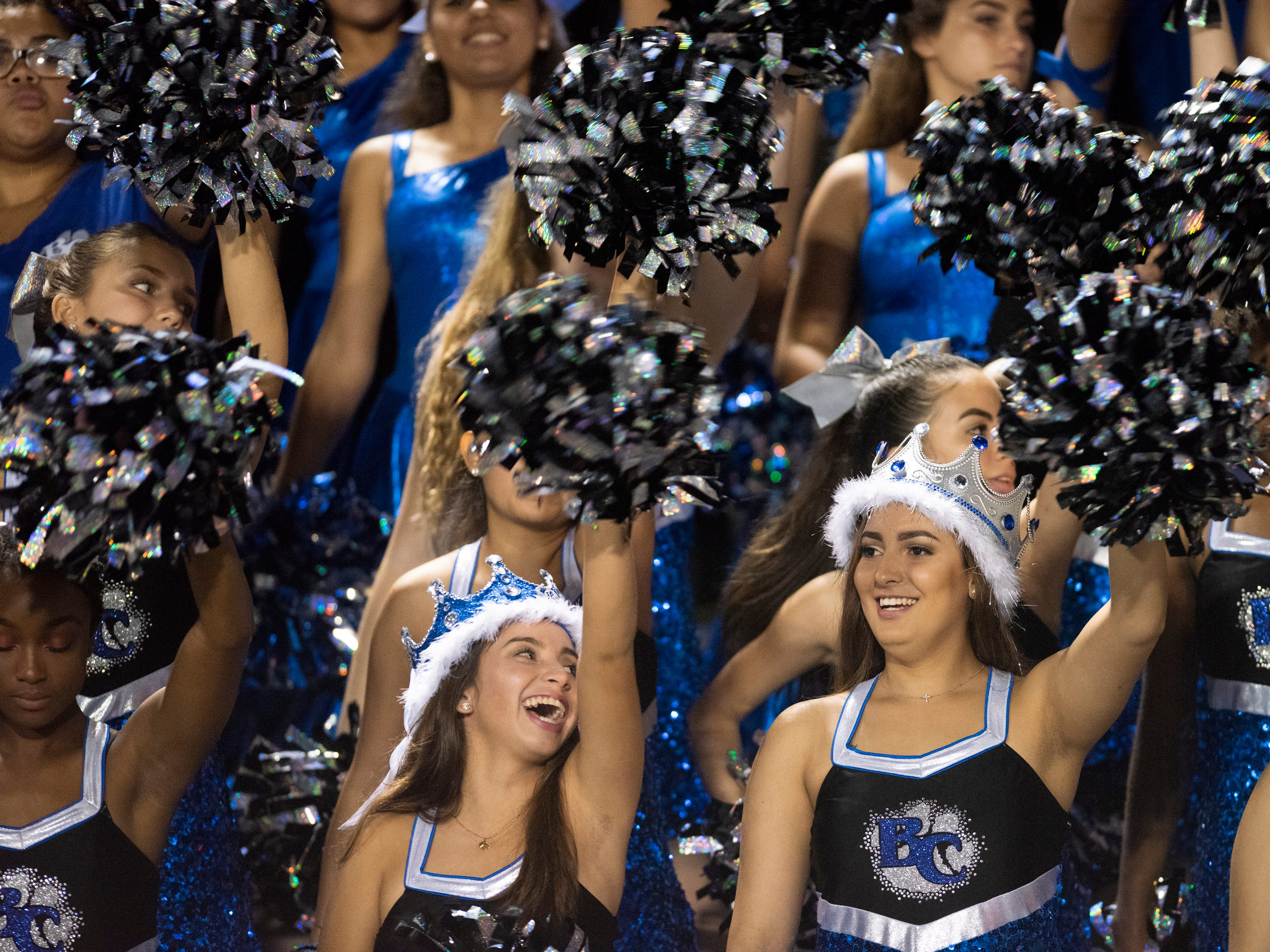 Members of the Barron Collier dance line cheer during the game against Mariner at Barron Collier High Friday night, September 21, 2018.