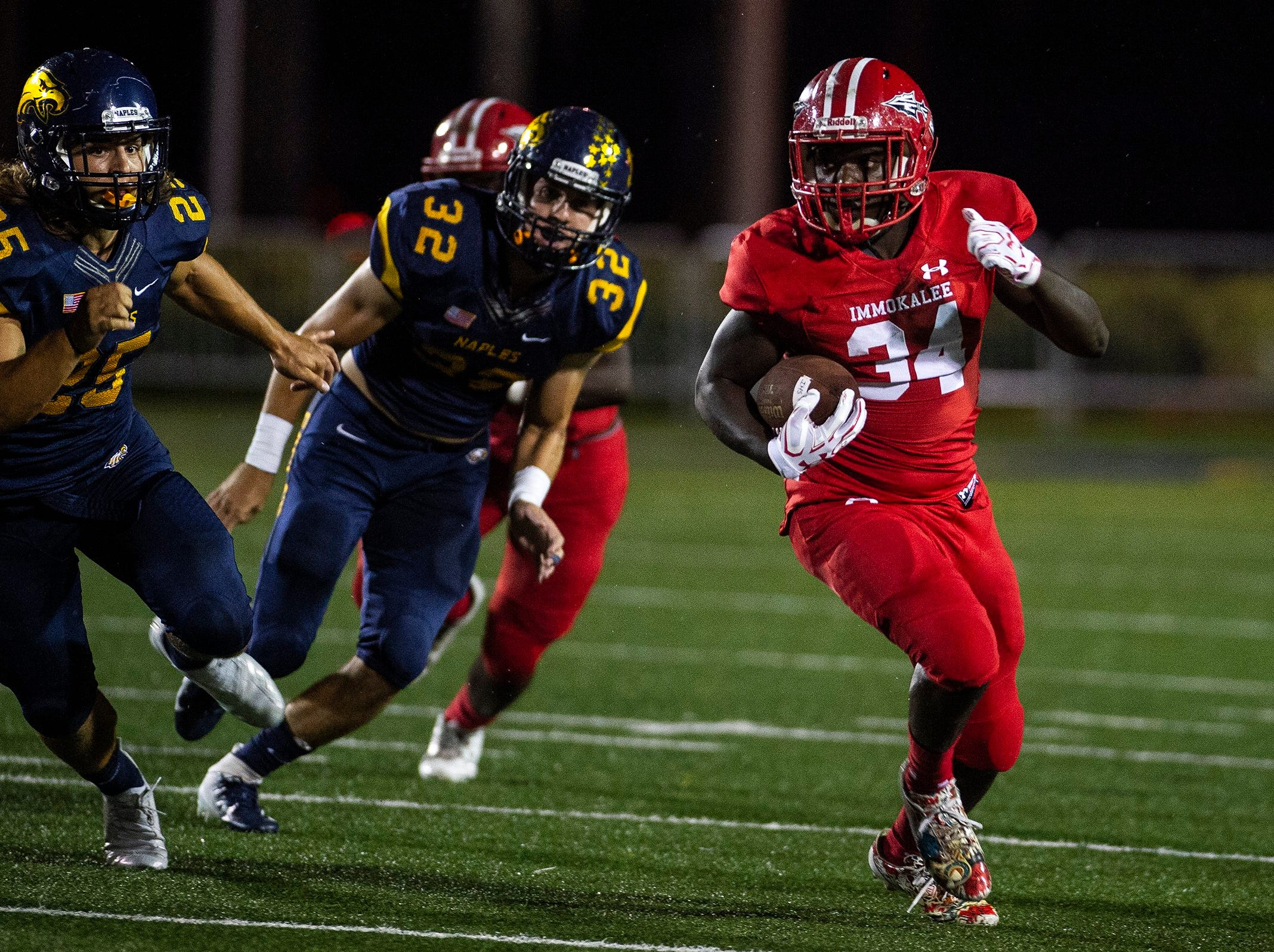 Immokalee High School's Dave Belrice runs the ball during a game against Naples High School in Naples, Fla. on Friday, September 21, 2018.