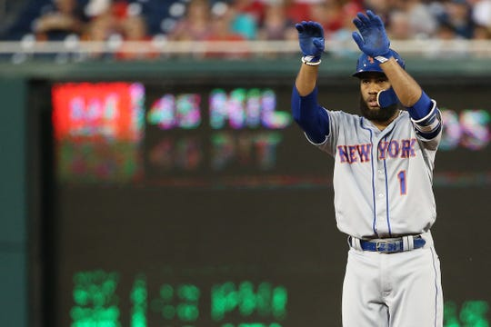 New York Mets shortstop Amed Rosario (1) gestures after hitting a double against the Washington Nationals in the first inning at Nationals Park.
