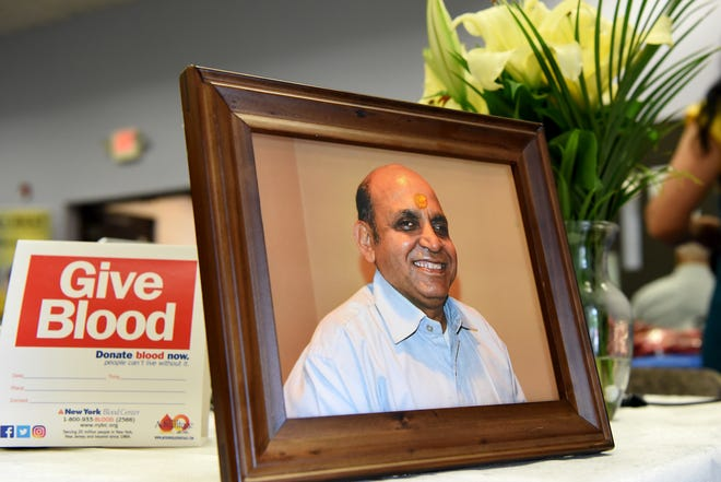 A photo of HitendraKumar Bhatt at the entrance to the blood drive dedicated in his honor at theMahatma Gandhi Center and Hindu Temple in Wayne on Saturday September 22, 2018.