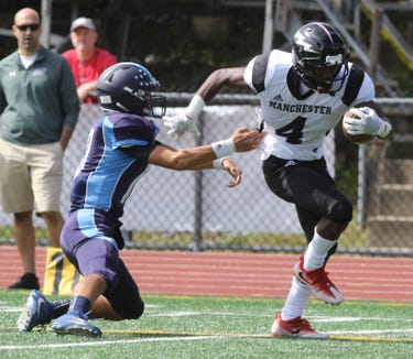 Ethan Kucharski of Waldwick can't keep Kristian McCoy of Manchester from scoring this touchdown in the first half.