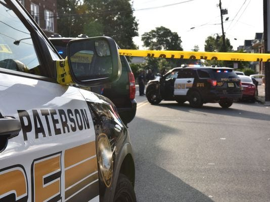 Paterson Police cars are pictured.