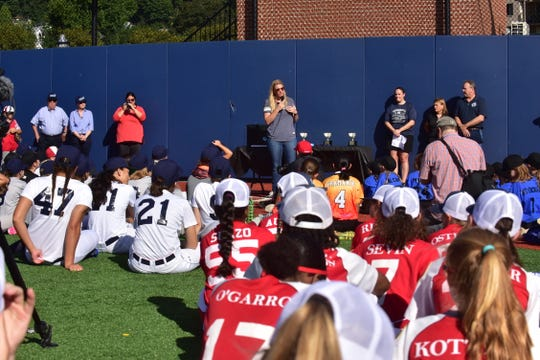 Baseball For All founder Justine Siegal, background standing, speaks at the Maria Pepe Baseball Series in Edgewater on September 22.