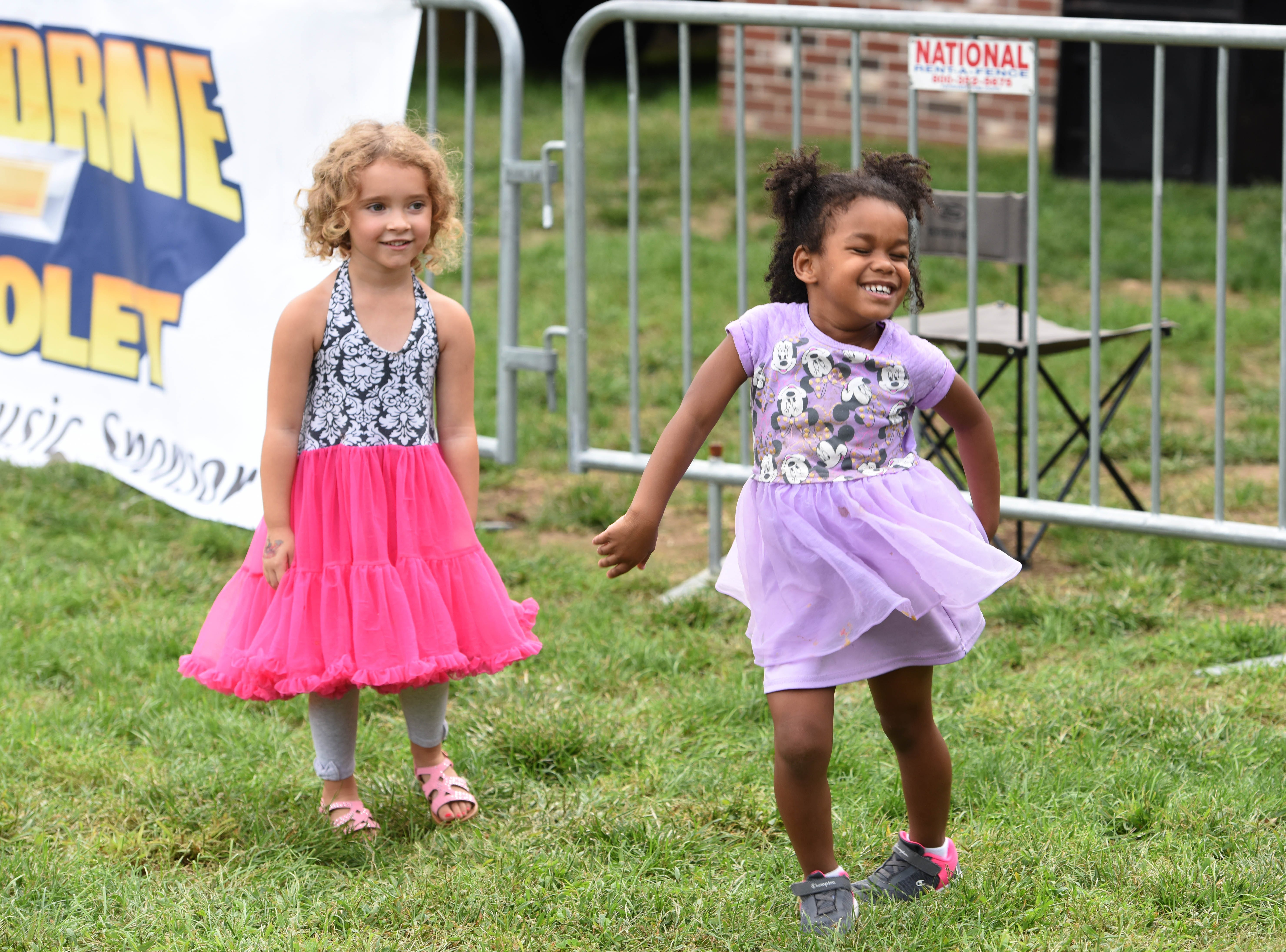 four-year-olds Hailey Stoll and Natalie Schroll dancing duringHawthorne Day