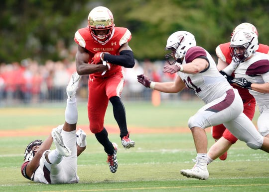 Don Bosco at Bergen Catholic on Saturday, September 22, 2018. BC #6 Rahmir Johnson avoids a tackle in the fourth quarter.