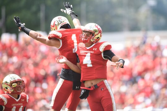 Don Bosco at Bergen Catholic on Saturday, September 22, 2018. BC #4 Andrew Boel celebrates after scoring a touchdown in the first quarter.