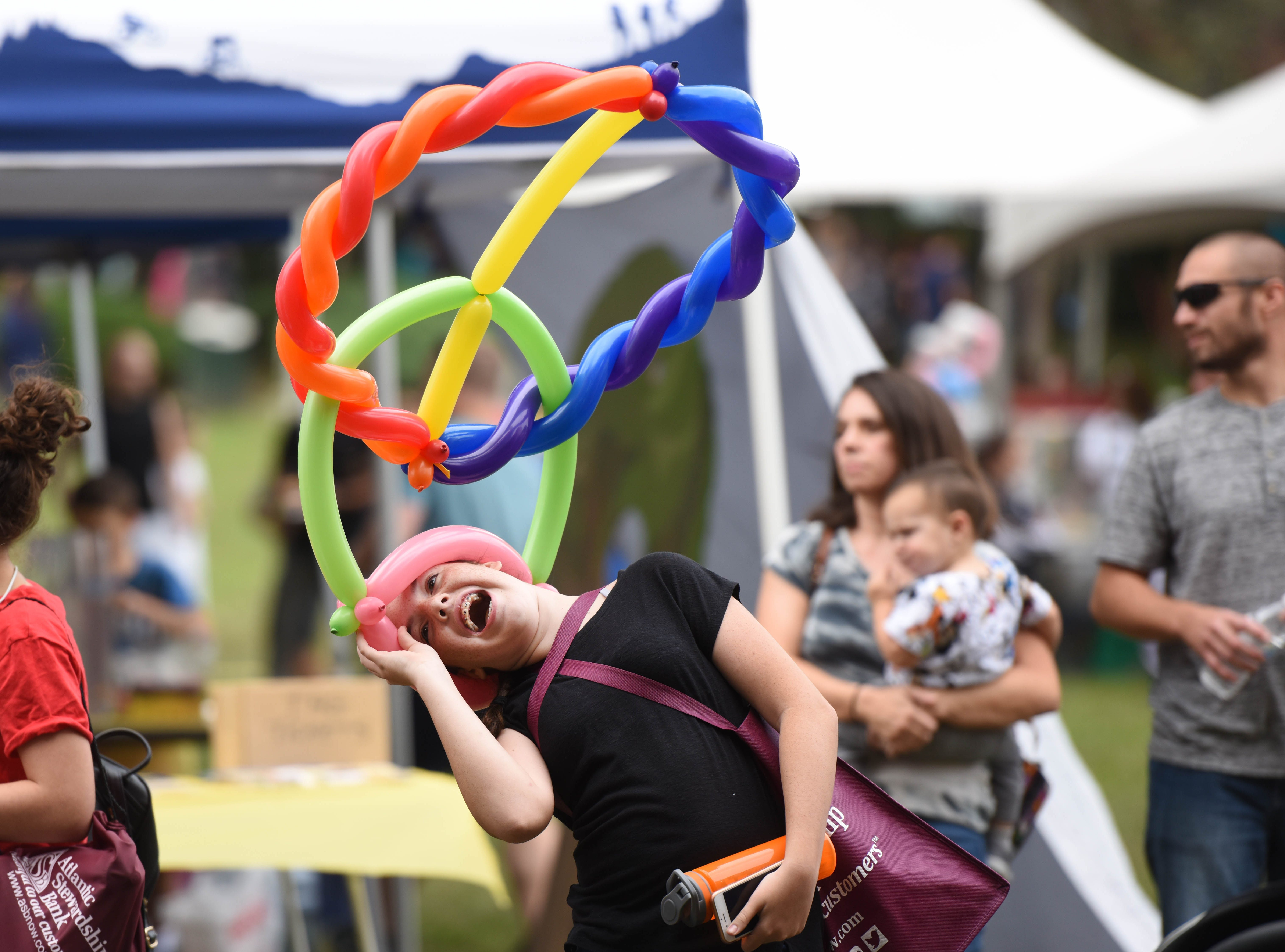12-year-old Emily Waddell try to fix her balloon headdress  Hawthorne Day -Blondie Lookalike