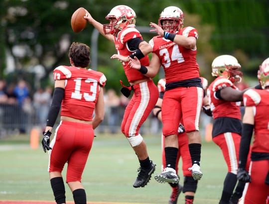 Don Bosco at Bergen Catholic on Saturday, September 22, 2018. BC #4 Andrew Boel and #34 Nick Vergona celebrate defeating Don Bosco.