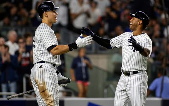 New York Yankees center fielder Aaron Hicks (31) is greeted by right fielder Aaron Judge (99) after hitting a two run home run in the fourth inning against the Baltimore Orioles at Yankee Stadium.