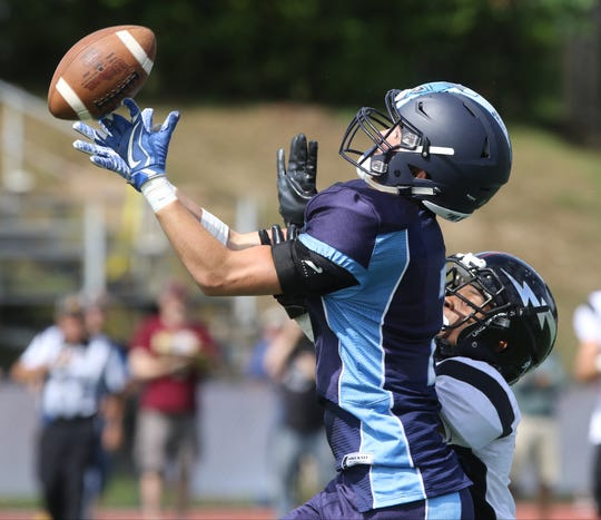 Joe Shafer of Waldwick has this pass broken up by Jamal Deloach of Manchester.