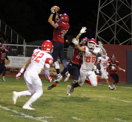 Junior Varela (31) made this interception in the fourth quarter and turned it into a 90-yard pick six.