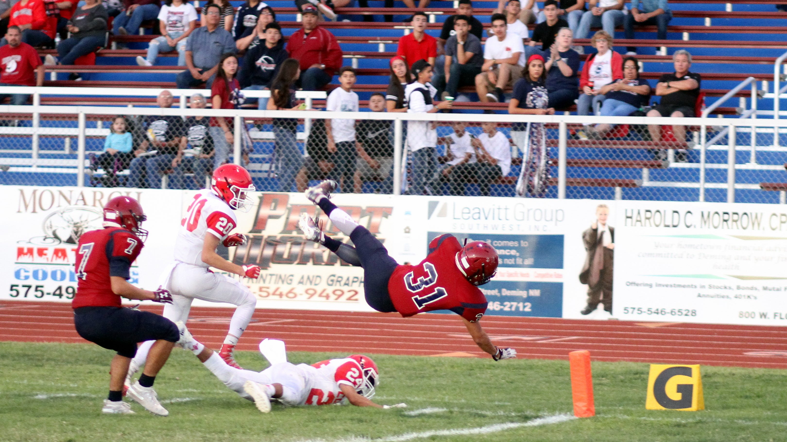 Junior Jesse Varela (31) is sent airborne toward the goal line against Cobre High Friday night. Varela turned a short swing pass into a 69-yard touchdown sprint to give the Wildcats a 14-0 first-quarter lead.