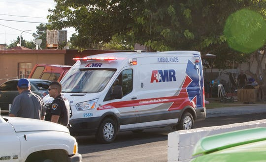 An AMR ambulance carrying a 6-year-old boy that was struck by a vehicle near the intersection of Cambridge Drive and Oxford Drive on Friday, Sept. 21, 2018, in Las Cruces leaves the crash scene and heads toward a dirt lot on North Main Street where an air ambulance awaited.