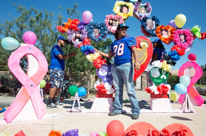 A colorful float passes by on Saturday, September 22, 2018, during the La Gran Fiesta Parade. The parade was held in conjunction with La Gran Fiesta which aims for assistance and resources to CARE victims and their families.