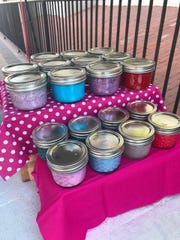 Jars of homemade slime, a creation of 12-year-old Mary Forbes, are for sale during a September 2018 Farmers & Crafts Market of Las Cruces event.