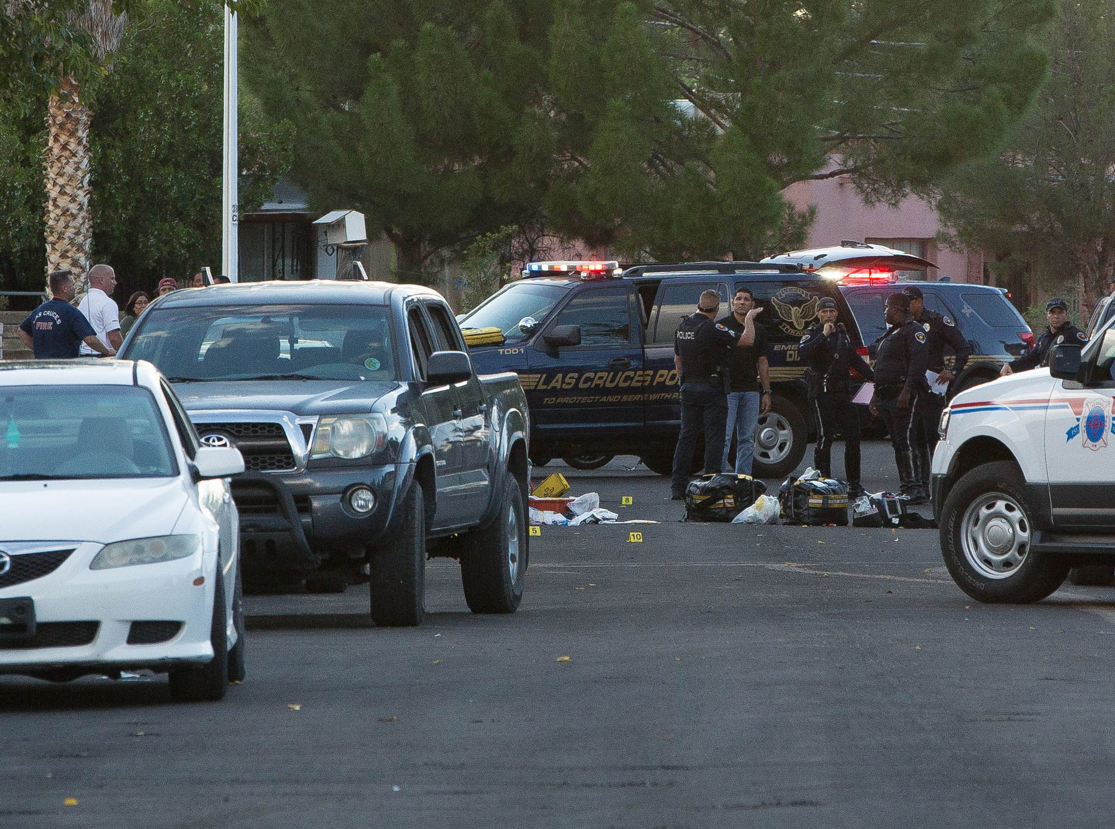 Las Cruces police officers investigate a scene where a 6-year-old boy was hit by a vehicle at the intersection of Oxford Drive and Cambridge Drive on Friday, Sept. 21, 2018.