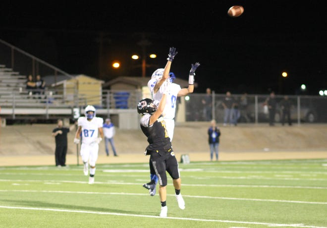 Lovington's Jayden Contreras leaps for the ball before Alamogordo's Tom Turnbull can get to it in the match-up on Sept. 21. Alamogordo lost, 45-7.