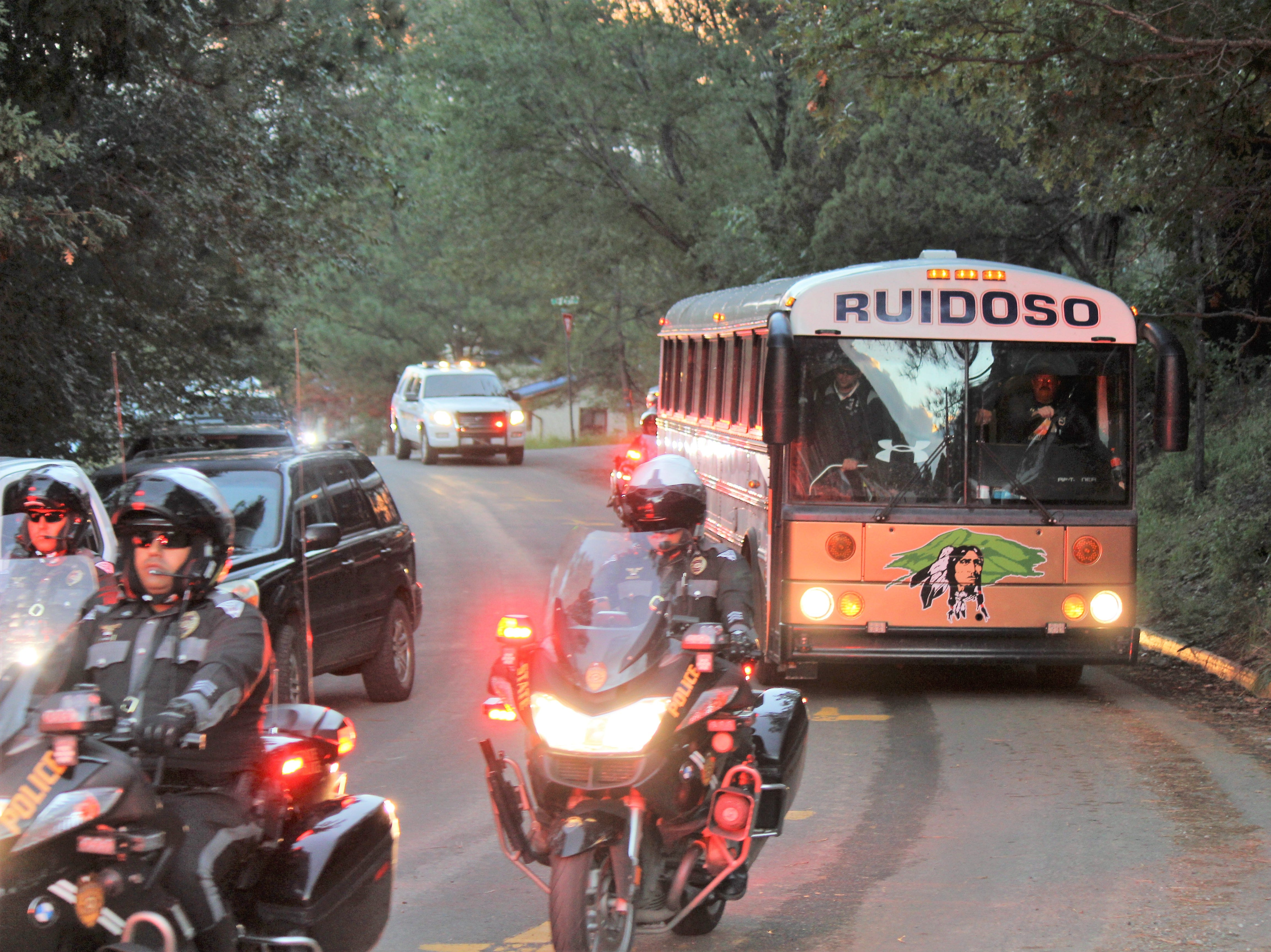Ruidoso Warriors Football team escorted by New Mexico State Police to their homecoming game Sept. 21.