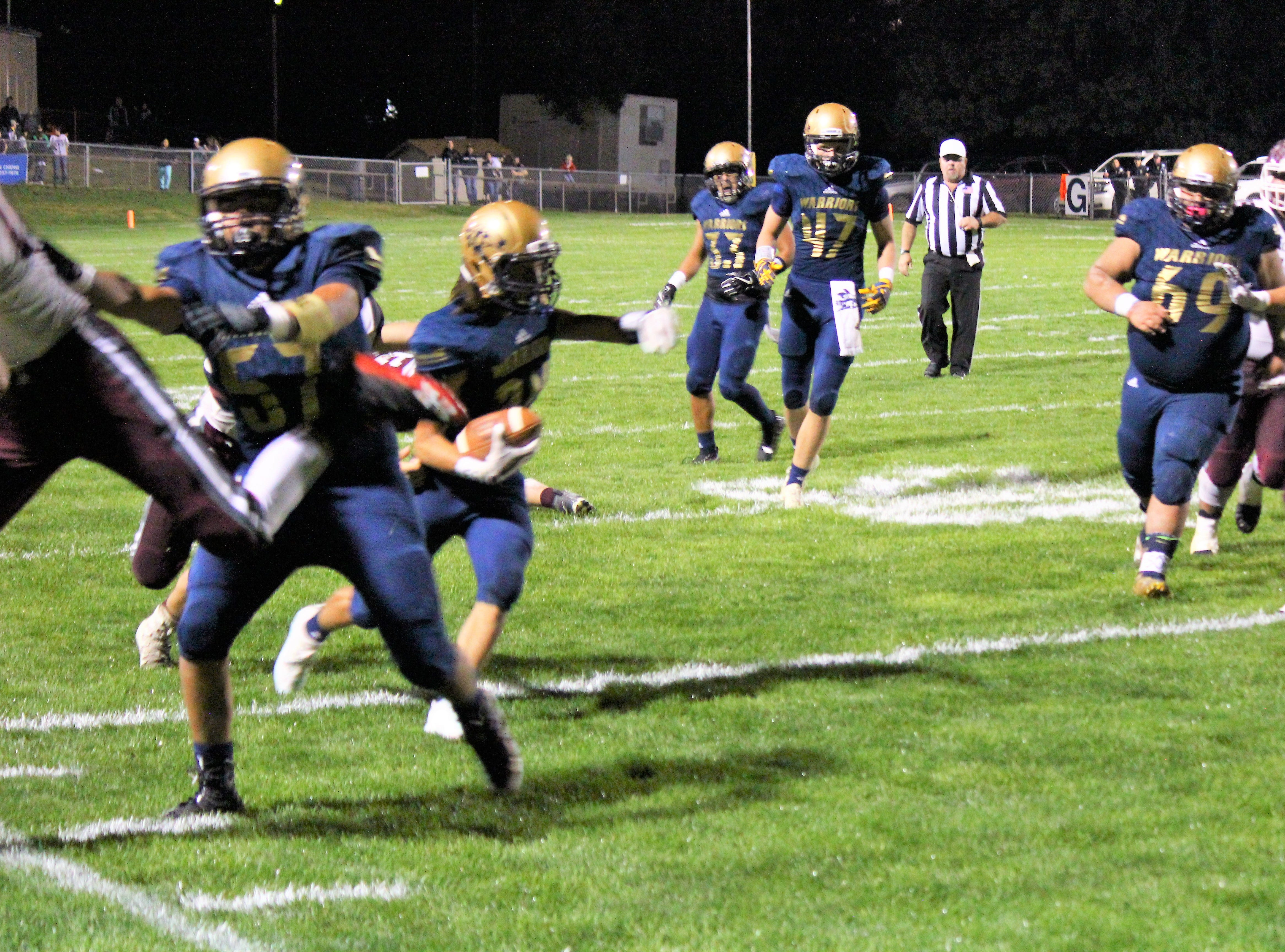 Warriors maintain the ball holding back the Wildcats at their homecoming game Sept. 21 winning 14-7.