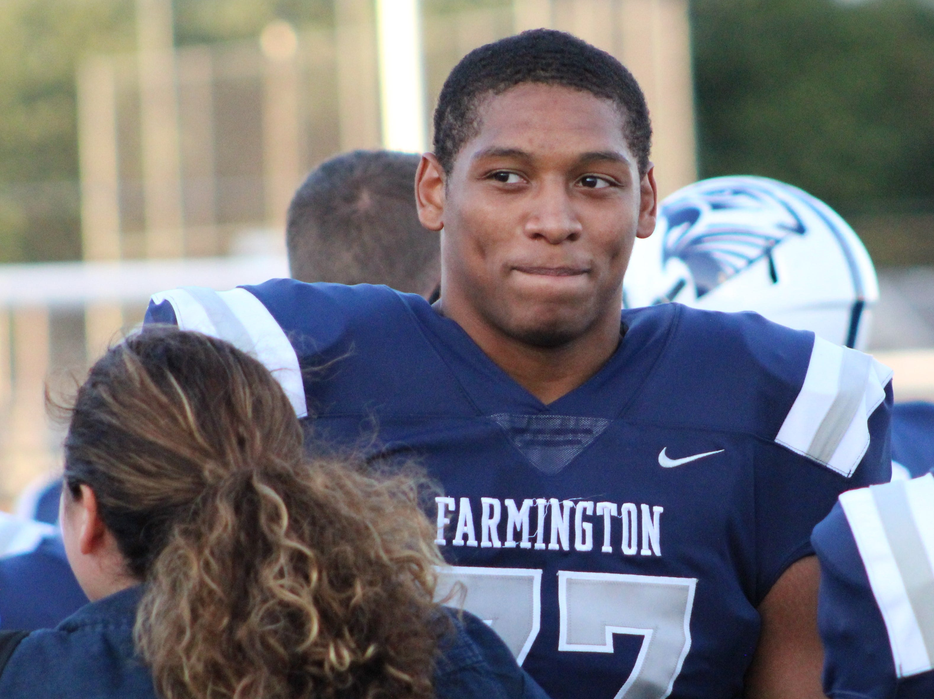 Out but not down, injured Donovan King finds ways to motivate his Farmington teammates